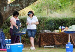 Two women preparing food