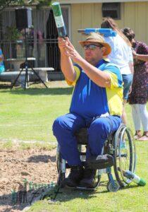Man in wheelchair throwing jukskei pin