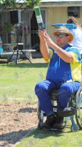 Man in wheelchair playing jukskei