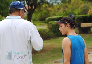 Experieced jukskei player teaching young man